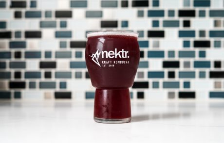 Glass NEKTR. Organic Kombucha Colorado Springs blueberry ginger